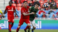 Toronto FC midfielder Jay Chapman (14) and Portland Timbers midfielder Cristhian Paredes (22) chase down a ball during second half MLS soccer action at BMO field in Toronto, Saturday, April 27, 2019. FILE/THE CANADIAN PRESS/Cole Burston