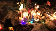 Hundreds lit candles, and laid flower and toys during a vigil to remember Jonathan and Nicolas Bastidas, who were found dead in their Brampton home last week. (CP24)