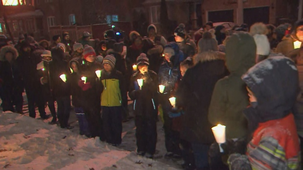 Family, friends, and schoolmates remembered Jonathan and Nicolas Bastidas at a vigil in front of their home in Brampton on Wednesday night. (CP24)