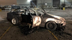 A burned-out vehicle is seen in this photograph provided by police. (Peel Regional Police/Twitter)