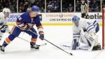 Toronto Maple Leafs goaltender Frederik Andersen (31) defends as New York Islanders' Anthony Beauvillier (18) attempts to score during the second period of an NHL hockey game Wednesday, Nov. 13, 2019, in Uniondale, N.Y. Beauvillier scored a goal on the play. (AP Photo/Frank Franklin II)