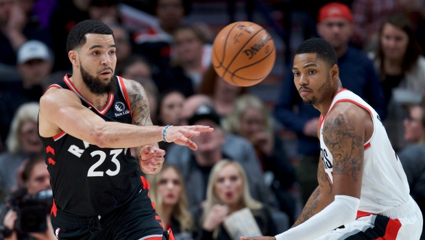Toronto Raptors guard Fred VanVleet, left, passes the ball away from Portland Trail Blazers guard Kent Bazemore during the first half of an NBA basketball game in Portland, Ore., Wednesday, Nov. 13, 2019. (AP Photo/Craig Mitchelldyer)