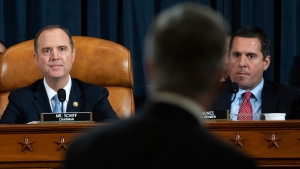 House Intelligence Committee Chairman Rep. Adam Schiff, D-Calif., left, and ranking member Rep. Devin Nunes, R-Calif., watch as Top U.S. diplomat in Ukraine William Taylor leaves after testifying at a hearing of the House Intelligence Committee on Capitol Hill in Washington, Wednesday, Nov. 13, 2019, during the first public impeachment hearing of President Donald Trump's efforts to tie U.S. aid for Ukraine to investigations of his political opponents. (Saul Loeb/Pool Photo via AP)
