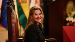 The opposition senator who has claimed Bolivia's presidency Jeanine Anez smiles during the swearing-in ceremony of her new cabinet at the presidential palace in La Paz, Bolivia, Wednesday, Nov. 13, 2019. Anez faces the challenge of stabilizing the nation and organizing national elections within three months at a time of political disputes that pushed former President Evo Morales to fly off to self-exile in Mexico after 14 years in power. (AP Photo/Juan Karita)