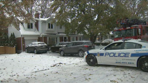 Police remain at the scene of a house fire in Mississauga on Thursday morning.
