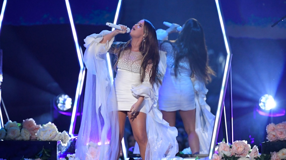 "Maren Morris performs ""Girl"" at the 53rd annual CMA Awards at Bridgestone Arena, Wednesday, Nov. 13, 2019, in Nashville, Tenn. (AP Photo/Mark J. Terrill)"