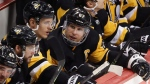 Pittsburgh Penguins' Sidney Crosby (87) talks with Nick Bjugstad (27) and Kris Letang (58) during the third period of an NHL hockey game in Pittsburgh, Tuesday, Oct. 29, 2019. The Penguins won 7-1. (AP Photo/Gene J. Puskar)