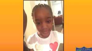 This Amber Alert made available by Jacksonville, Fla. police, shows an undated photo of Taylor Williams. On Tuesday, Nov. 12, 2019, authorities in Alabama say they have found human remains while searching in the woods for Williams. The child was reported missing from her Jacksonville, Fla., home last Wednesday. (Jacksonville Police via AP)