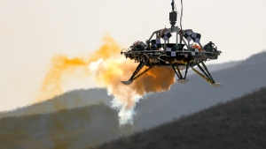 A lander is lifted during a test of hovering, obstacle avoidance and deceleration capabilities at a facility in Huailai in China's Hebei province, Thursday, Nov. 14, 2019. China has invited international observers to the test of its Mars lander as it pushes for inclusion in more global space projects. The test was conducted at a site outside Beijing simulating conditions on the Red Planet, where the pull of gravity is about one-third that of Earth. (AP Photo/Andy Wong)