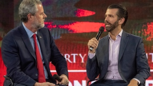 Donald Trump Jr., right, speaks as Liberty University president Jerry Falwell Jr. listens during a panel discussion at a Liberty University Convocation, Wednesday, Nov.13, 2019, in Lynchburg, Va. (AP Photo/Don Petersen)