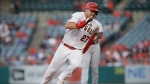 FILE - In this July 30, 2019, file photo, Los Angeles Angels' Mike Trout rounds second to advance to third from first on a single by Shohei Ohtani against the Detroit Tigers during the first inning of a baseball game in Anaheim, Calif. (AP Photo/Alex Gallardo, File)