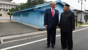 FILE - In this June 30, 2019, file photo, U.S. President Donald Trump, left, meets with North Korean leader Kim Jong Un at the border village of Panmunjom in Demilitarized Zone, South Korea. (AP Photo/Susan Walsh, File)