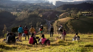 Venezuelan migrants look out from a grassy knoll at the Panamericana Highway, in Urbina, Ecuador, on August 27, 2019. The ripples from Venezuela's collapse are shifting Canada's Western Hemisphere neighbourhood, creating major long-term costs for the new Liberal minority government. South America's borders remain the same, but the outflow of more than 4.5 million Venezuelan refugees in other countries is predicted to grow to more than six million by the end of 2020, according to new estimates from the United Nations refugee agency. That's nearly one in five Venezuelans. THE CANADIAN PRESS/AP, Edu Leon