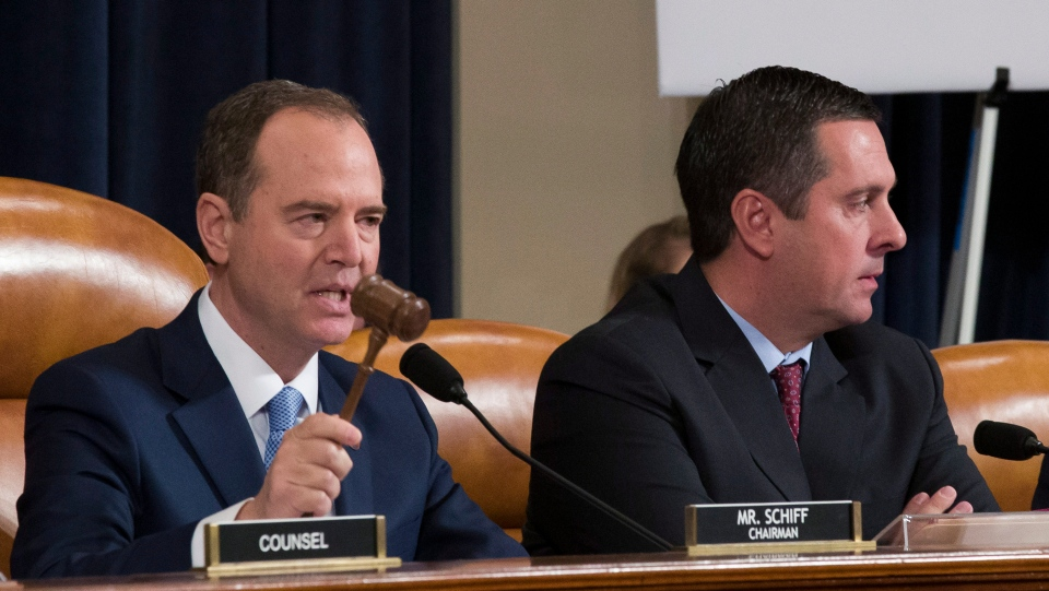 House Intelligence Committee Chairmen Rep. Adam Schiff, D-Calif., left, uses the gavel to restore order as ranking member Rep. Devin Nunes, R-Calif., left, watches, as former Ambassador to Ukraine Marie Yovanovitch testifies before the House Intelligence Committee on Capitol Hill in Washington, Friday, Nov. 15, 2019, during the second public impeachment hearing of President Donald Trump's efforts to tie U.S. aid for Ukraine to investigations of his political opponents. (AP Photo/Alex Brandon)