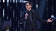 Host Michael Buble is shown on stage at the Juno Awards in Vancouver on March, 25, 2018. Canadian crooner Michael Buble is set to revisit the hits of his musical career in a multi-network special on Wednesday. The one-hour show will air at 10 p.m. on Rogers-owned Citytv as well as Bell's CTV and online streaming service Crave. THE CANADIAN PRESS/Darryl Dyck
