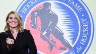 Hockey Hall of Fame inductee Hayley Wickenheiser shows off her ring on stage in Toronto on Friday, November 15, 2019. THE CANADIAN PRESS/Nathan Denette