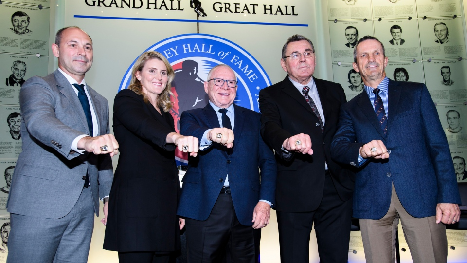 Hockey Hall of Fame inductees Sergei Zubov, (left to right) Hayley Wickenheiser, Jim Rutherford, Vaclav Nedomansky and Guy Carbonneau show off their rings as they pose for a photograph in Toronto on Friday, November 15, 2019. THE CANADIAN PRESS/Nathan Denette