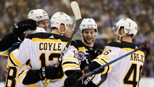 Boston Bruins centre Charlie Coyle (13) celebrates his goal with defenceman Matt Grzelcyk (48) defenceman Brandon Carlo (25) left wing Anders Bjork (10) and centre David Krejci (46) during first period NHL hockey action against the Toronto Maple Leafs in Toronto on Friday, Nov. 15, 2019. THE CANADIAN PRESS/Frank Gunn