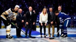 Members of the Hockey Hall of Fame's inductee class of 2019, back row left to right, Jim Rutherford, Sergei Zubov, Hayley Wickenheiser, Guy Carbonneau and Vaclav Nedomansky take part in a ceremonial face-off with Boston Bruins captain Zdeno Chara (33) and Toronto Maple Leafs captain John Tavares (91) ahead of first period NHL hockey action in Toronto on Friday, Nov. 15, 2019. THE CANADIAN PRESS/Frank Gunn