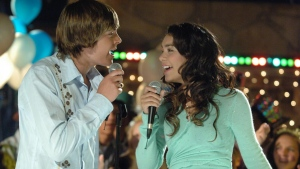 "Actors Zac Efron, as basketball star Troy, left, and Vanessa Anne Hudgens, as the shy academic Gabriella, discover they share a passion for singing in a scene from ""High School Musical,"" in this undated photo released by the Disney Channel. When ""High School Musical"" debuted on the Disney Channel on Jan. 20, 2006, it drew nearly 8 million viewers, making it the top-rated basic cable TV show that week. (AP Photo/Disney Channel)"