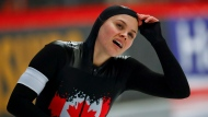Canada's Marsha Hudey looks at the scoreboard after competing in the women's 500 meters race at the ISU single distance Speedskating World Championships in Inzell, Germany, Friday, Feb. 8, 2019. (AP Photo/Matthias Schrader)