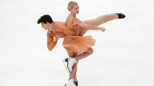 Canada's Piper Gilles and Paul Poirier perform during the free dance at the ISU Grand Prix of Figure Skating- Rostelecom Cup in Moscow, Russia, Saturday, Nov. 16, 2019. (AP Photo/Alexander Zemlianichenko)