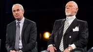 "Ron MacLean (left) sits with Don Cherry as Rogers TV unveils their team for the station's NHL coverage in Toronto on Monday, March 10, 2014. Cherry has sparked a furor on social media after he called his Coach's Corner co-host MacLean a ""savage"" and a ""barbarian"" for eating seal meat. THE CANADIAN PRESS/Chris Young"