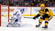 Toronto Maple Leafs goaltender Kasimir Kaskisuo (50) stops a shot by Pittsburgh Penguins' Sam Lafferty (37) during the second period of an NHL hockey game in Pittsburgh, Saturday, Nov. 16, 2019. (AP Photo/Gene J. Puskar)