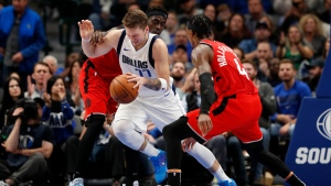 Dallas Mavericks guard Luka Doncic (77) is fouled by Toronto Raptors' Pascal Siakam as Rondae Hollis-Jefferson (4) looks on in the second half of an NBA basketball game in Dallas, Saturday, Nov. 16, 2019. (AP Photo/Tony Gutierrez)