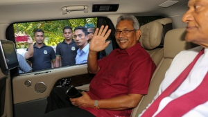 Sri Lanka's former Defense Secretary and presidential candidate Gotabaya Rajapaksa, waves to media as he leaves for the election commission from his residence in Colombo, Sri Lanka, Sunday, Nov.17, 2019. Rajapaksa, revered by Sri Lanka's ethnic majority for his role in ending a bloody civil war but feared by minorities for his brutal approach, declared victory Sunday in the nation's presidential election. (AP Photo/Lahiru Harshana)