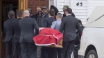 The flag-draped coffin of Lionel Desmond is carried into St. Peter's Church in Tracadie, N.S. on Wednesday, Jan. 11, 2017. It was almost three years ago that Desmond - a deeply disturbed Afghan war veteran diagnosed with PTSD - killed his mother, wife and young daughter before taking his own life in the family's rural Nova Scotia home.THE CANADIAN PRESS/Andrew Vaughan