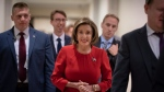 Speaker of the House Nancy Pelosi, D-Calif., arrives to talk to reporters on the morning after the first public hearing in the impeachment probe of President Donald Trump on his effort to tie U.S. aid for Ukraine to investigations of his political opponents, on Capitol Hill in Washington, Thursday, Nov. 14, 2019. (AP Photo/J. Scott Applewhite)