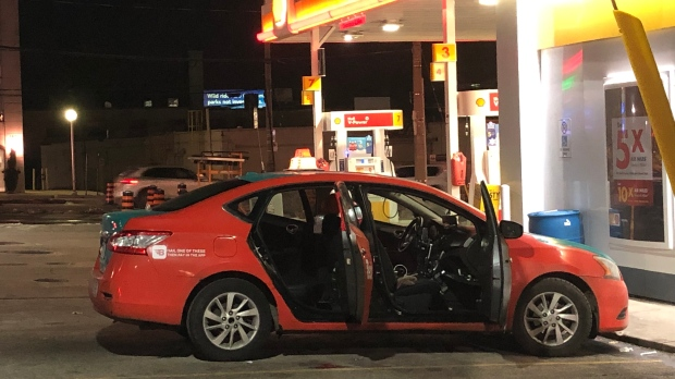 A taxi cab is seen at a gas station near Bayview and Eglinton, where a shooting injured one man. (Miranda Anthistle/CP24)