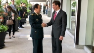 Chinese Defense Minister Wei Fenghe, left, greets U.S. Defense Secretary Mark Esper in Bangkok, Thailand, Monday, Nov. 18, 2019. The two held their first face-to-face talks Monday. (AP Photo/Robert Burns)