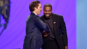 Rapper Kanye West, right, shakes hands with Joel Osteen during a service at Lakewood Church, Sunday, Nov. 17, 2019, in Houston. (AP Photo/Michael Wyke)