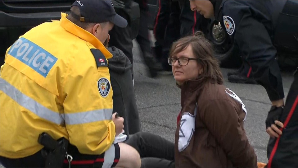 "Police prepare to detain an ""Extinction Rebellion"" protester on Oct. 7, 2019. (CP24)"