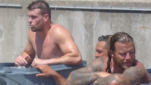 Toronto Wolfpack forwards Darcy Lussick, left, and Ashton Sims, right, sit in ice baths following a training session in Toronto on July 4, 2018. THE CANADIAN PRESS/Neil Davidson