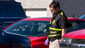 A member of the Oklahoma State Bureau of Investigation works the scene of a fatal shooting in the parking lot of a Walmart in Duncan, Okla., on Monday, Nov. 18, 2019. (Chris Landsberger/The Oklahoman via AP)