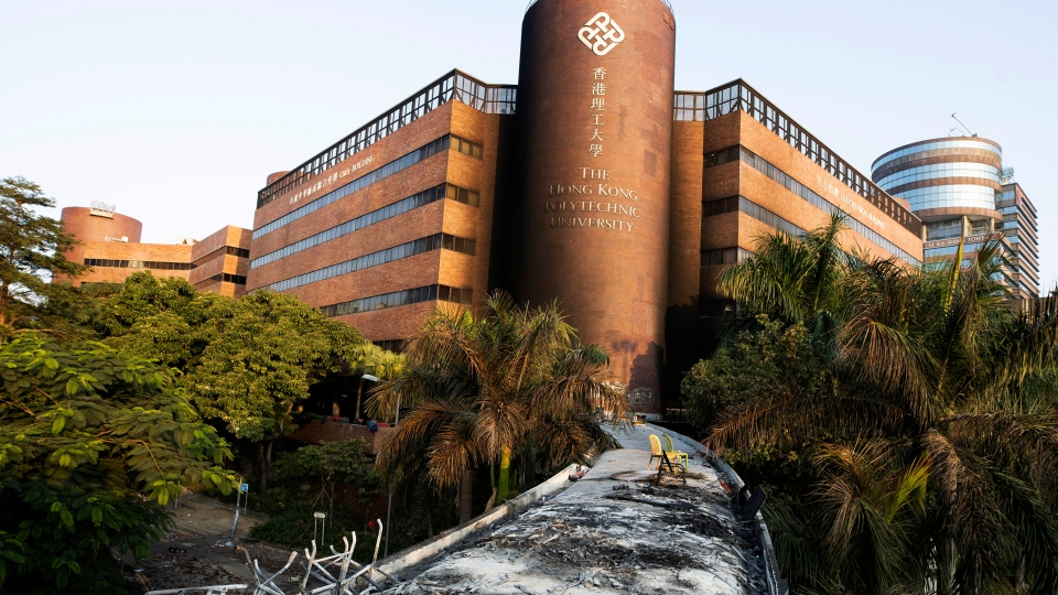 A charred rooftop leads to the Hong Kong Polytechnic University after police attempted to storm the building in Hong Kong on Tuesday, Nov. 19, 2019. (AP Photo/Ng Han Guan)