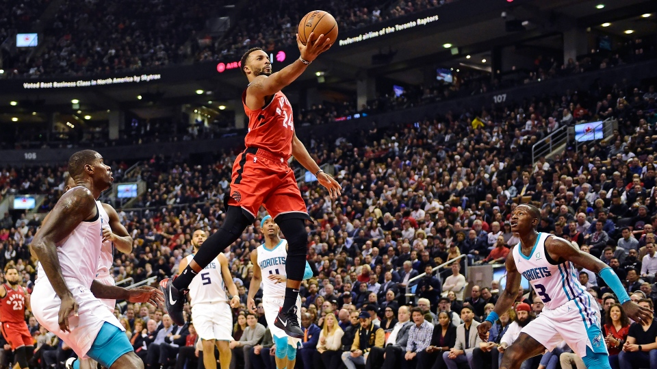 Toronto Raptors guard Norman Powell (24) soars through Charlotte Hornets defenders during first half NBA action in Toronto on Monday, Nov. 18, 2019. THE CANADIAN PRESS/Frank Gunn