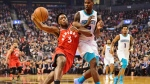 Toronto Raptors forward OG Anunoby (3) drives as Charlotte Hornets forward Marvin Williams (2) defends during first half NBA action in Toronto on Monday, Nov. 18, 2019. THE CANADIAN PRESS/Frank Gunn