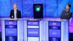 "FILE - In this Thursday, Jan. 13, 2011, file photo, ""Jeopardy!"" champions Ken Jennings, left, and Brad Rutter look on as an IBM computer called ""Watson"" beats them to the buzzer to answer a question during a practice round of the ""Jeopardy!"" quiz show in Yorktown Heights, N.Y. The three top money winners in ""Jeopardy!"" history, Ken Jennings, Brad Rutter and James Holzhauer, will vie for a share of $1.5 million in January 2020. (AP Photo/Seth Wenig, File)"
