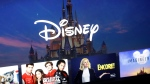 FILE - In this Wednesday, Nov. 13, 2019 file photo, a Disney logo forms part of a menu for the Disney Plus movie and entertainment streaming service on a computer screen in Walpole, Mass. (AP Photo/Steven Senne, File)
