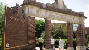 FILE - This June 12, 2006 file photo shows a gate with a historic marker on the Ohio University campus in Athens, Ohio. In October 2019, the university announced the blanket suspension of 15 fraternities in response to a hazing investigation on campus. (AP Photo/Joe Maiorana, File)
