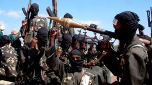 In this Dec. 8, 2008 file photo, armed al-Shabab fighters on pickup trucks prepare to travel into the city, just outside Mogadishu, in Somalia. (AP Photo/Farah Abdi Warsameh)