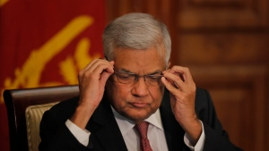 FILE- In this Oct. 30, 2019 file photo, Sri Lankan Prime Minister Ranil Wickremesinghe attends a meeting with media representatives and civil society members at his office in Colombo, Sri Lanka. Wickremesinghe plans to step down, clearing the way for Parliament to choose a new prime minister to work with newly elected President Gotabaya Rajapaksa. (AP Photo/Eranga Jayawardena, File)