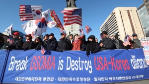 Protesters against South Korean President Moon Jae-in stage a rally demanding the government to keep the General Security of Military Information Agreement, or GSOMIA, an intelligence-sharing agreement between South Korea and Japan, in Seoul, South Korea, Wednesday, Nov. 20, 2019. Squeezed between a growing North Korean threat and a shaky alliance with the United States, South Korea must decide this week whether its national pride and deep frustrations with Japan are worth killing a major symbol of their security cooperation with Washington. (AP Photo/Ahn Young-joon)