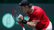 Canadian Denis Shapovalov celebrates a point against Taylor Fritz of the USA during their Davis Cup tennis match in Madrid, Spain, Tuesday, Nov. 19, 2019. (AP Photo/Manu Fernandez)