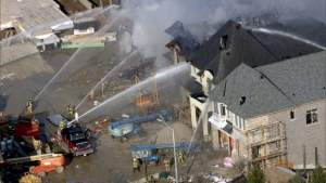 Two homes under construction collapsed after a fire broke out in Richmond Hill on Wednesday afternoon.