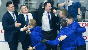 Toronto Marlies head coach Sheldon Keefe, second left, celebrates with his coaching and training staff after defeating the Texas Stars to win the AHL Calder Cup championship in Toronto on June 14, 2018. THE CANADIAN PRESS/Nathan Denette